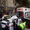 An injured person is carried into an ambulance after an explosion at an adjacent building to the executive tower of Mexico\'s state-owned oil company PEMEX, in Mexico City, Thursday Jan. 31, 2013. An explosion at the main headquarters of Mexico\'s state-owned oil company in the capital killed more than 10 people and injured some 80 as it heavily damaged three floors of the building, sending hundreds into the streets and a large plume of smoke over the skyline. (AP Photo/Eduardo Verdugo)