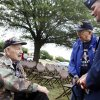 World War II veteran Art Levine (left) speaks with fellow World War II veteran Stan Newman (center) and Air Force colonel Devin Wooden at the 45th Infantry Division Memorial Day ceremony in Oklahoma City, Monday, May 26, 2014. Both Levine and Newman served in the European theatre of the war. Levine was a member of the 101st Airborne and Newman flew a P51 Mustang.