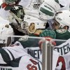 Minnesota Wild\'s Nino Niederreiter, center, of Switzerland, is mobbed by teammates after he scored the winning goal off Nashville Predators goalie Carter Hutton in overtime of an NHL hockey game, Thursday, Feb. 6, 2014, in St. Paul, Minn. The Wild won 3-2. (AP Photo/Jim Mone)