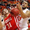 OSU\'s Marshall Moses (33), right, and Anatoly Bose (31) of Nicholls State chase a loose ball in the first half during the men\'s college basketball game between Nicholls State University and Oklahoma State University at Gallagher-Iba Arena in Stillwater, Okla., Saturday, Nov. 21, 2010. Photo by Nate Billings, The Oklahoman