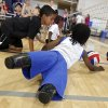 Harvey Parry, 7, of the UK, and Miles Thomas, 8, of Indiana, left, play in the sitting volleyball clinic during the opening day of activities for the Endeavor Games at the University of Central Oklahoma on Thursday, June 6, 2013 in Edmond, Okla. Photo by Chris Landsberger, The Oklahoman