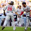 Washington Nationals right fielder Jayson Werth (28) celebrates a solo homerun with teammate Adam LaRoche (25) in the first inning of a baseball game against the Los Angeles Dodgers, Monday, Sept. 1, 2014, in Los Angeles. (AP Photo/Gus Ruelas)