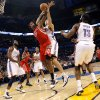 Oklahoma City\'s Nenad Krstic disrupts a shot by Houston\'s Jordan Hill during their NBA basketball game at the OKC Arena in downtown Oklahoma City on Wednesday, Nov. 17, 2010. The Thunder beat the Rockets 116-99. Photo by John Clanton, The Oklahoman