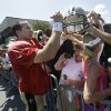 Photo - New Orleans Saints quarterback Drew Brees (9) signs autographs during their NFL football training camp in Metairie, La., Monday, July 29, 2013. (AP Photo/Gerald Herbert)