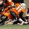 Oklahoma\'s Jeremy Beal (44) forces a fumble by Oklahoma State\'s Zac Robinson (11) during the second half of the college football game between the University of Oklahoma Sooners (OU) and Oklahoma State University Cowboys (OSU) at Boone Pickens Stadium on Saturday, Nov. 29, 2008, in Stillwater, Okla. The fumble was returned by OU for a safety. STAFF PHOTO BY CHRIS LANDSBERGER