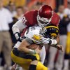 Oklahom\'s R.J. Washington (91) sacks James Vandenberg (16) during the Insight Bowl college football game between the University of Oklahoma (OU) Sooners and the Iowa Hawkeyes at Sun Devil Stadium in Tempe, Ariz., Friday, Dec. 30, 2011. Photo by Sarah Phipps, The Oklahoman