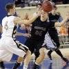 Okemah\'s John Wingfield (4) passes the ball past Sequoyah\'s Ryan Helsley (24) during the state high school basketball tournament Class 3A boys semifinal game between Okemah High School and Sequoyah High School at the State Fair Arena on Friday, March 8, 2013, in Oklahoma City, Okla. Photo by Chris Landsberger, The Oklahoman