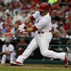 St. Louis Cardinals\' Kolten Wong hits an RBI double scoring Matt Carpenter during the first inning of a baseball game against the New York Yankees Monday, May 26, 2014, in St. Louis. (AP Photo/Jeff Roberson)