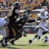 Oklahoma State\'s Joseph Randle (1) gets by the Missouri defense during a college football game between the Oklahoma State University Cowboys (OSU) and the University of Missouri Tigers (Mizzou) at Faurot Field in Columbia, Mo., Saturday, Oct. 22, 2011. Photo by Sarah Phipps, The Oklahoman