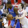 Oklahoma City\'s DeAndre Liggins grabs a rebound beside Houston\'s Omer Asik during Game 3 in the first round of the NBA playoffs between the Oklahoma City Thunder and the Houston Rockets at the Toyota Center in Houston, Texas, Saturday, April 27, 2013. Photo by Bryan Terry, The Oklahoman
