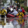 People, some waving to those on dry ground, are rescued by boat in Little Ferry, N.J. Tuesday, Oct. 30, 2012 in the wake of superstorm Sandy. Sandy, the storm that made landfall Monday, caused multiple fatalities, halted mass transit and cut power to more than 6 million homes and businesses. (AP Photo/Craig Ruttle) ORG XMIT: NJCR215