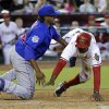 Photo - Chicago Cubs pitcher Edwin Jackson, left, tags out Arizona Diamondbacks' Didi Gregorius at the plate after Gregorius tried to score on a wild pitch during the fifth inning of a baseball game, Friday, July 18, 2014, in Phoenix. (AP Photo/Matt York)