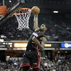 Photo - Miami Heat forward LeBron James dunks after a breakaway against the Sacramento Kings during the first half of an NBA basketball game in Sacramento, Calif., on Friday, Dec. 27, 2013.(AP Photo/Steve Yeater)