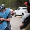 Ray Miller, left, hugs his wife Cindy before he heads into the burn zone with a police escort Friday, June 14, 2013 to try to retrieve medication from their home that was burned to the ground in the Black Forest fire near Colorado Springs, Colo. Little more than 36 hours after it started in the Black Forest area northeast of Colorado Springs, the blaze surpassed last June\'s Waldo Canyon fire as the most destructive in state history. That blaze burned 347 homes and killed two people. Bradley thinks her home escaped the fire. (AP Photo/The Gazette, Michael Ciaglo)