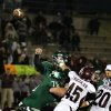 Edmond Santa Fe\'s quarterback Justice Hansen releases the ball for a 26 yard touchdown pass during the Edmond Santa Fe - Jenks game at UCO\'s Wantland Stadium in Edmond, Friday, November 18, 2011. PHOTO BY HUGH SCOTT, FOR THE OKLAHOMAN