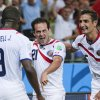 Photo - Costa Rica's Marco Urena (21) celebrates with Celso Borges, right, and Joel Campbell (9) after Urena scored his side's third goal during the group D World Cup soccer match between Uruguay and Costa Rica at the Arena Castelao in Fortaleza, Brazil, Saturday, June 14, 2014.