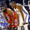Houston\'s James Harden (13) and Kevin Durant (35) rest their hands on their knees during Game 2 in the first round of the NBA playoffs between the Oklahoma City Thunder and the Houston Rockets at Chesapeake Energy Arena in Oklahoma City, Wednesday, April 24, 2013. Oklahoma City won, 105-102. Photo by Nate Billings, The Oklahoman
