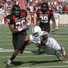 Texas Tech\'s LaRon Moore runs past OU\'s Brian Simmons after an interception during the college football game between the University of Oklahoma Sooners (OU) and Texas Tech University Red Raiders (TTU ) at Jones AT&T Stadium in Lubbock, Texas, Saturday, Nov. 21, 2009. Photo by Bryan Terry, The Oklahoman