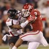 Texas Tech\'s D.J. Johnson (12) stops Oklahoma\'s Brennan Clay (3) during the college football game between the University of Oklahoma Sooners (OU) and Texas Tech University Red Raiders (TTU) at the Gaylord Family-Oklahoma Memorial Stadium on Saturday, Oct. 22, 2011. in Norman, Okla. Photo by Chris Landsberger, The Oklahoman