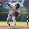 Photo - New York Mets starting pitcher Jenrry Mejia works against the Colorado Rockies in the first inning of a baseball game in Denver, Saturday, May 3, 2014. (AP Photo/David Zalubowski)