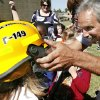 Senior firefighter Randy Sanders places a helmet on a girl as he shows her and fellow students from Good Shepherd Lutheran School some of the equipment worn by firefighters during their visit to the city hall complex Wednesday afternoon, Oct. 8, 2008. Midwest City firefighters are conducting fire safety training for elementary school students as part of the department\'s Fire Prevention Month activities. BY JIM BECKEL, THE OKLAHOMAN