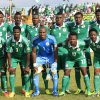 Photo - FILE - In this Nov. 16, 2013 file photo, Nigeria soccer team poses prior to start the World Cup qualifying match between Nigeria and Ethiopia at U. J. Esuene Stadium, in Calabar, Nigeria. Background from left:  Mikel John Obi, Omeruo Kenneth, Ideye Brown, Emenike Emmanuel, Godfrey Oboabona, and Ambrose Efe. Foreground from left: Victor Moses, Echieille Elderson, Enyeama Vincent, Onazi Ogenyi, and Amhed Musa. (AP Photo/Sunday Alamba, File)