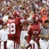 Former OU tight end Trent Smith, left, and receiver Curtis Fagan high five after a touchdown against UTEP in 2000. OKLAHOMAN ARCHIVE PHOTO.