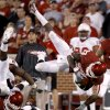 Oklahoma\'s Brandon Williams (23) flies through the air during the college football game between the University of Oklahoma Sooners (OU) and the Ball State Cardinals at Gaylord Family-Memorial Stadium on Saturday, Oct. 01, 2011, in Norman, Okla. Photo by Bryan Terry, The Oklahoman