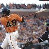 Photo - San Francisco Giants' Pablo Sandoval hits an RBI double off Miami Marlins starting pitcher Henderson Alvarez as Marlins catcher Jarrod Saltalamacchia watches during the first inning of a baseball game Friday, May 16, 2014, in San Francisco. (AP Photo/Eric Risberg)