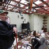 Brian Bernard looks around what remains of his living room at his Petal, Miss., home Tuesday, Feb. 12, 2013 following the Sunday afternoon tornado. Bernard, his wife and 13-year-old daughter were hiding in a hallway when the tornado hit the house. (AP Photo/Rogelio V. Solis)