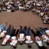Photo - Demonstrators lie on the ground holding statistics about the people murdered in the 14 years of Chavista government, at a protest in Caracas, Venezuela, Friday, March 7, 2014. Venezuela is coming under increasing international scrutiny amid violence that most recently killed a National Guardsman and a civilian. United Nations human rights experts demanded answers Thursday from Venezuela's government about the use of violence and imprisonment in a crackdown on widespread demonstrations. (AP Photo/Fernando Llano)