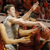 Oklahoma State's Mitchell Solomon (41) ties up the ball with Iowa State's Abdel Nader (2) during a college basketball game between the Oklahoma State Cowboys (OSU) and the Iowa State Cyclones (ISU) at Gallagher-Iba Arena in Stillwater, Okla., Saturday, Feb. 6, 2016. OSU lost 59-64. Photo by Bryan Terry, The Oklahoman