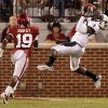 Utah State\'s Xavier Martin catches a touchdown pass in front of OU\'s Demontre Hurst during the second half of the college football game between the University of Oklahoma Sooners (OU) and Utah State University Aggies (USU) at the Gaylord Family-Oklahoma Memorial Stadium on Saturday, Sept. 4, 2010, in Norman, Okla. Photo by Bryan Terry, The Oklahoman