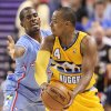 Photo - The Los Angeles Clippers' Chris Paul covers the Denver Nuggets' Randy Foye during the first half of a preseason NBA basketball game on Saturday, Oct. 19, 2013, in Las Vegas. (AP Photo/Isaac Brekken)