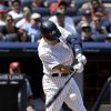 New York Yankees\' Derek Jeter hits an RBI single during the fifth inning of a baseball game against the Cincinnati Reds at Yankee Stadium on Sunday, July 20, 2014, in New York. (AP Photo/Seth Wenig)