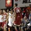 Oklahoma\'s Buddy Hield (24) and the Oklahoma bench celebrate his three-point shot in front of Oklahoma State\'s Brian Williams (4) during the men\'s Bedlam college game between Oklahoma and Oklahoma State at Gallagher-Iba Arena in Stillwater, Okla., Saturday, Feb. 15, 2014. Photo by Sarah Phipps, The Oklahoman