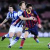 FC Barcelona\'s Lionel Messi, from Argentina, right, duels for the ball against Real Sociedad\'s Carlos Martinez during a Copa del Rey soccer match at the Camp Nou stadium in Barcelona, Spain, Wednesday, Feb. 5, 2014. (AP Photo/Manu Fernandez)