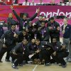 Members of the United States men\'s basketball team display the gold medal during a ceremony at the 2012 Summer Olympics, Sunday, Aug. 12, 2012, in London. (AP Photo/Matt Slocum)