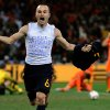 """Photo - FILE - In this July 11, 2010 file photo, Spain's Andres Iniesta celebrates after scoring a goal, with the words """"Dani Jarque, always with us"""", written on his undershirt, during the World Cup final soccer match between the Netherlands and Spain, at Soccer City in Johannesburg, South Africa. On this day: Four minutes from the end of extra time, Iniesta scores to win the World Cup for Spain for the first time. (AP Photo/Martin Meissner, File)"""