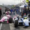 Photo - Pippa Mann (63) pulls out of the pits during practice for Indianapolis 500 IndyCar auto race at the Indianapolis Motor Speedway in Indianapolis, Wednesday, May 14, 2014. (AP Photo/Darron Cummings)