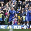 Photo - Chelsea's captain John Terry, left, celebrates with teammates after scoring against Everton during an English Premier League soccer match at the Stamford Bridge ground in London, Saturday, Feb. 22, 2014. Chelsea won the match 1-0. (AP Photo / Lefteris Pitarakis)