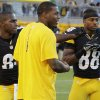 Photo -   Pittsburgh Steelers wide receivers Antonio Brown, left, Mike Wallace, center, Emmanuel Sanders (88) visit during warmups before an NFL preseason football game against the Carolina Panthers in Pittsburgh, Thursday, Aug. 30, 2012. (AP Photo/Gene J. Puskar)