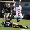 Oklahoma wide receiver Trey Franks (2) flips over after getting hit by Baylor cornerback Joe Williams (22) in the first half of an NCAA college football game, Saturday, Nov. 19, 2011, in Waco, Texas. (AP Photo/Waco Tribune Herald, Rod Aydelotte)