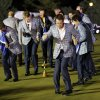 European players dance around the trophy on the practice green after the Ryder Cup PGA golf tournament Sunday, Sept. 30, 2012, at the Medinah Country Club in Medinah, Ill. (AP Photo/David J. Phillip) ORG XMIT: PGA255