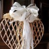 MEET JOANNA....A heart wreath hung on the front door of Susie and Jay Nelson\'s home. They entertained at a party for their son, Ryan Nelson and his bride-to be Joann Souders. (Photo by Helen Ford Wallace).