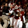 OU\'s Brent Venables pats Travis Lewis after the Sooners stopped Tech on a fourth down play to take over possession during the first half of the college football game between the University of Oklahoma Sooners and Texas Tech University at the Gaylord Family -- Oklahoma Memorial Stadium on Saturday, Nov. 22, 2008, in Norman, Okla. BY STEVE SISNEY, THE OKLAHOMAN