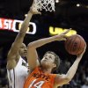 Oklahoma\'s Marek Soucek (14) shoots over Missouri\'s Matt Pressey (3) during the Big 12 tournament men\'s basketball game between the Oklahoma State Cowboys and Missouri Tigers the Sprint Center, Thursday, March 8, 2012. Photo by Sarah Phipps, The Oklahoman