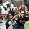 New York Jets running back Shonn Greene, left, carries the ball before being brought down by St. Louis Rams middle linebacker James Laurinaitis, right, during the third quarter of an NFL football game, Sunday, Nov. 18, 2012, in St. Louis. (AP Photo/Seth Perlman)