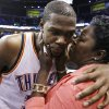 Oklahoma City Thunder\'s Kevin Durant (35) is embraced and kissed by his mother, Wanda Pratt, after the Thunder\'s 109-103 win over the San Antonio Spurs in Game 4 of the NBA basketball playoffs Western Conference finals, Saturday, June 2, 2012, in Oklahoma City. (AP Photo/Eric Gay) ORG XMIT: OKKJ153