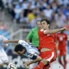 Photo - Argentina's Lionel Messi fights for the ball with Switzerland's Admir Mehmedi during the World Cup round of 16 soccer match between Argentina and Switzerland at the Itaquerao Stadium in Sao Paulo, Brazil, Tuesday, July 1, 2014. Argentina beat Switzerland 1-0 after extra time.(AP Photo/Kirsty Wigglesworth)